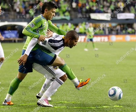 Stock Picture of Fredy Montero, Leonardo Seattle Sounders' Fredy Montero, left, and Los Angeles Galaxy's Leonardo vie for the ball in the second half of an MLS soccer match, in Seattle. THe Galaxy beat the Sounders 1-0