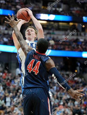 Kyle Singler, Solomon Hill Duke's Kyle Singler shoots over Arizona's Solomon Hill (44) during the first half of a West regional semifinal in the NCAA college basketball tournament, in Anaheim, Calif