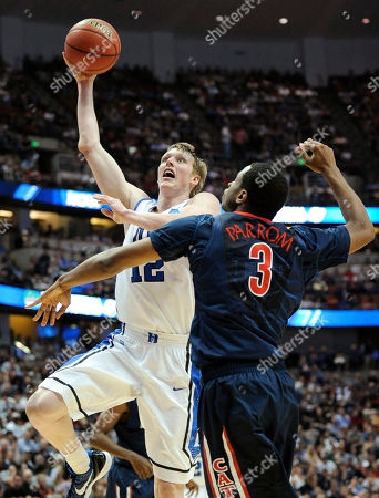 Kyle Singler, Kevin Parrom Duke's Kyle Singler (12) shoots in front of Arizona's Kevin Parrom (3) during the first half of a West regional semifinal in the NCAA college basketball tournament, in Anaheim, Calif