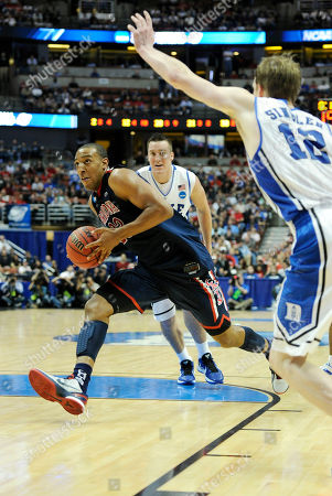 Derrick Williams, Kyle Singler Arizona's Derrick Williams (23) drives into the lane past Duke's Kyle Singler (12) during the second half of a West regional semifinal game in the NCAA college basketball tournament, in Anaheim, Calif. Arizona defeated Duke 93-77
