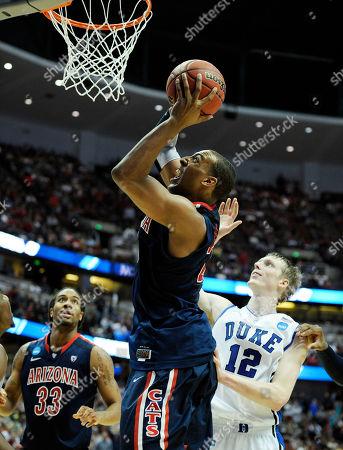 Derrick Williams;Kyle Singler Arizona's Derrick Williams (23) shoots over Duke's Kyle Singler (12) during the second half of a West regional semifinal game in the NCAA college basketball tournament, in Anaheim, Calif. Arizona defeated Duke 93-77