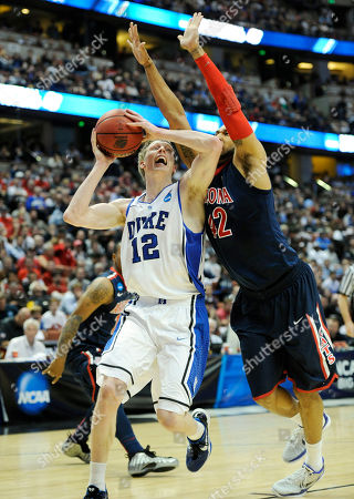 Kyle Singler;Jamelle Horne Duke's Kyle Singler (12) tries to get past Arizona's Jamelle Horne (42) during the first half of a West regional semifinal game in the NCAA college basketball tournament, in Anaheim, Calif. Arizona defeated Duke 93-77