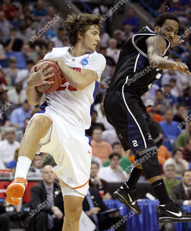 Stock Picture of Florida's Chandler Parsons (25) pulls in a rebound against Butler's Shawn Vanzant during the second half of the NCAA Southeast regional college basketball championship game, in New Orleans