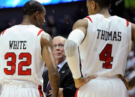 Stock Image of Steve Fisher, Bill White, Malcolm Thomas San Diego State coach Steve Fisher talks with Bill White (32) and Malcolm Thomas (4) during the first half against Connecticut in a West regional semifinal in the NCAA college basketball tournament, in Anaheim, Calif