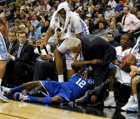 Brandon Knight, Roy Williams Kentucky's Brandon Knight (12) falls into North Carolina head coach Roy Williams in the second half of the final of the NCAA men's college basketball tournament East regional, in Newark, N.J. Kentucky won the game 76-69