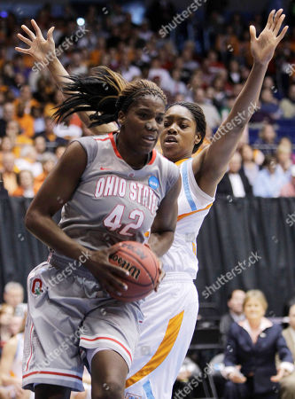 Jantel Lavender, Vicki Baugh Ohio State center Jantel Lavender (42) drives past Tennessee forward Vicki Baugh during the first half of an NCAA women's college basketball tournament regional semifinal, in Dayton, Ohio