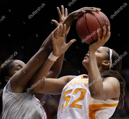 Jantel Lavender, Kelley Cain Ohio State center Jantel Lavender, left, blocks a shot by Tennessee center Kelley Cain (52) during the second half of an NCAA women's college basketball tournament regional semifinal, in Dayton, Ohio. Tennessee won 85-75