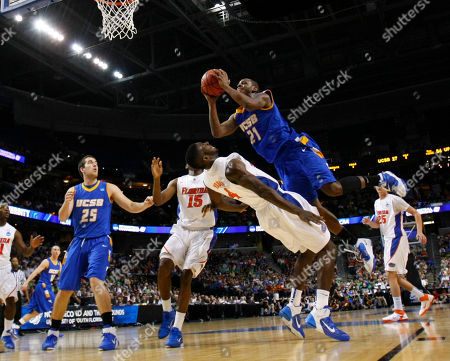 James Nunnally, Patric Young UC Santa Barbara's James Nunnally (21) runs into Florida's Patric Young (4) during the second half of a Southeast regional second-round NCAA tournament college basketball game in Tampa, Fla