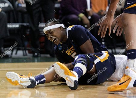 Sarah Miles West Virginia guard Sarah Miles grabs her right leg after colliding with Baylor guard Odyssey Sims in the second half of a second-round game of the NCAA women's college basketball tournament, in Waco, Texas. Miles left the game with an unknown injury and did not return in the 82-68 Baylor win