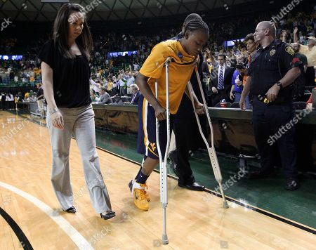 Sarah Miles West Virginia guard Sarah Miles leaves the court on crutches following their second-round game against Baylor in the NCAA women's college basketball tournament, in Waco, Texas. Miles left the game with an unknown right leg injury and did not return in the 82-68 loss to Baylor