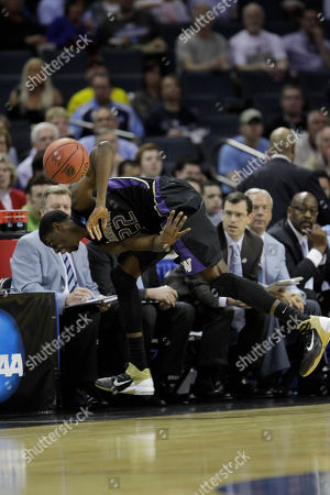 Washington forward Justin Holiday (22) heads to the bench vying for a loose ball against the North Carolina in the first half of a East Regional NCAA tournament third round college basketball game, in Charlotte, N.C