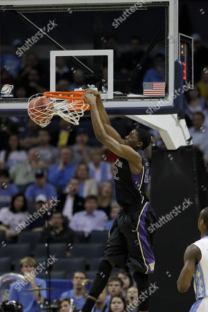 Washington forward Justin Holiday (22) dunks against the North Carolina in the first half of a East Regional NCAA tournament third round college basketball game, in Charlotte, N.C