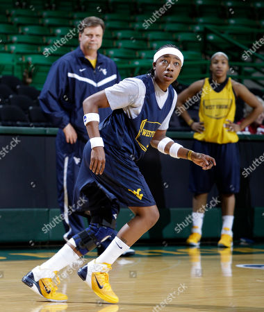 Mike Carey, Sarah Miles West Virginia's Sarah Miles and coach Mike Carey, cener rear, during practice in the first round of the NCAA women's college basketball tournament, in Waco, Texas. West Virginia plays Houston on Sunday
