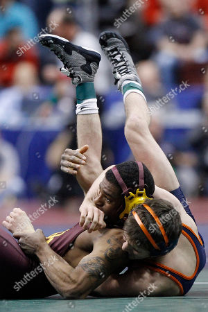 Anthony Robles, Matthew Snyder Arizona State's Anthony Robles, left, struggles against Virginia's Matthew Snyder during their 125-pound first round match, at the NCAA Division I Wrestling Championships in Philadelphia