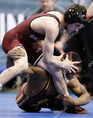 Anthony Robles, Jarrod Patterson Oklahoma's Jarrod Patterson, left, tries to escape Arizona State's Anthony Robles during their 125-pound quarterfinals match, at the NCAA Division I Wrestling Championships in Philadelphia
