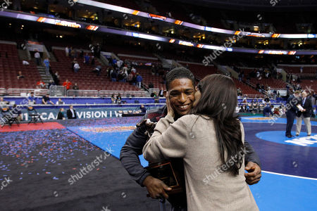 Anthony Robles, Judy Robles Arizona State's Anthony Robles, left, get a kiss from his mom, Judy Robles after he won the outstanding wrestler award, at the NCAA Division I Wrestling Championships in Philadelphia