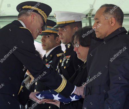 Stock Image of Daren Hidalgo, Miles Hidalgo, Jared Hidalgo, Andrea Hidalgo, Jorge Hidalgo West Point Superintendent Lt. Gen. David Huntoon, Jr., left, presents an American flag to Andrea Hidalgo as her husband Jorge, right, stands with her during a graveside service for their son 1st Lt. Daren Hidalgo, in West Point, N.Y., on . Hidalgo, of Waukesha, Wis., and a 2009 graduate of West Point, died Feb. 20 in Kandahar province after insurgents attacked his unit with an improvised explosive device. His brothers Army Capt. Miles Hidalgo, left, and Marine Capt. Jared Hidalgo look on