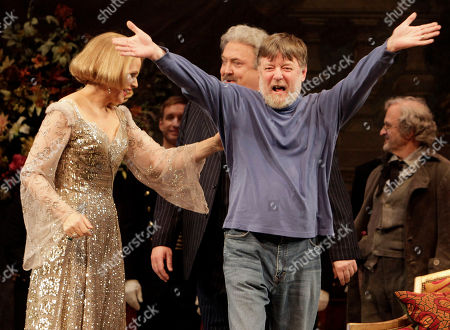 """Andrew Davis, Renee Fleming, Peter Rose Conductor Andrew Davis, right, raises his arms as he takes a bow, accompanied by Renee Fleming, and Peter Rose, center, during the final dress rehearsal of Richard Strauss's """"Capriccio"""" in the Metropolitan Opera at New York's Lincoln Center"""