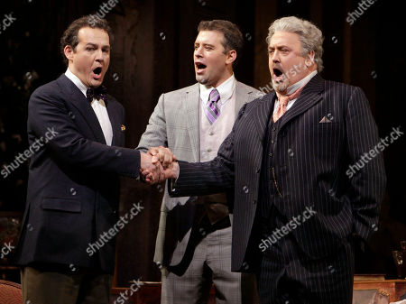 """Peter Rose, Russell Braun, Joseph Kaiser From left, Russell Braun, as Olivier, Joseph Kaiser, as Flamand, and Peter Rose, as La Roche are shown during the final dress rehearsal of Richard Strauss's """"Capriccio"""" in the Metropolitan Opera at New York's Lincoln Center"""