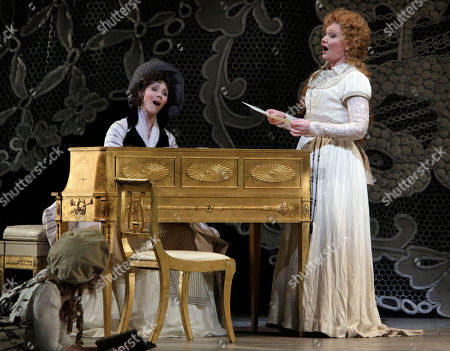 """Tamara Mumford, Karita Mattila Tamara Mumford, left, and Karita Mattila sing during the final dress rehearsal of Peter Ilyich Tchaikovsky's """"Queen of Spades"""" at New York's Metropolitan Opera. Tchaikovsky's """"Queen of Spades"""" unfolds with the feverish intensity of a nightmare, punctuated by intervals of courtly elegance and pastoral innocence that offer only brief respite from a gathering sense of doom. In the revival of Elijah Moshinsky's 1995 production that opened at the Metropolitan Opera on Friday night, these elements are perfectly balanced, thanks to fine performances by a starry cast and the supple shaping of the score by conductor Andris Nelsons"""