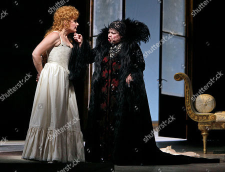 """Dolora Zajic, Karita Mattila Karita Mattila, right, portrays Lisa, and Dolora Zajic portrays The Countess during the final dress rehearsal of Peter Ilyich Tchaikovsky's """"Queen of Spades"""" at New York's Metropolitan Opera. Tchaikovsky's """"Queen of Spades"""" unfolds with the feverish intensity of a nightmare, punctuated by intervals of courtly elegance and pastoral innocence that offer only brief respite from a gathering sense of doom. In the revival of Elijah Moshinsky's 1995 production that opened at the Metropolitan Opera on Friday night, these elements are perfectly balanced, thanks to fine performances by a starry cast and the supple shaping of the score by conductor Andris Nelsons"""