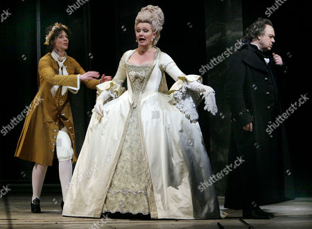 """Karita Mattila, Vladimir Galouzine, Tamara Mumford Tamara Mumford, left, Karita Mattila, center, and Vladimir Galouzine plays Hermann perform during the final dress rehearsal of Peter Ilyich Tchaikovsky's """"Queen of Spades"""" at New York's Metropolitan Opera. Tchaikovsky's """"Queen of Spades"""" unfolds with the feverish intensity of a nightmare, punctuated by intervals of courtly elegance and pastoral innocence that offer only brief respite from a gathering sense of doom. In the revival of Elijah Moshinsky's 1995 production that opened at the Metropolitan Opera on Friday night, these elements are perfectly balanced, thanks to fine performances by a starry cast and the supple shaping of the score by conductor Andris Nelsons"""