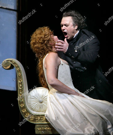 """Karita Mattila, Vladimir Galouzine Karita Mattila portrays Lisa and Vladimir Galouzine plays Hermann during the final dress rehearsal of Peter Ilyich Tchaikovsky's """"Queen of Spades"""" at New York's Metropolitan Opera. Tchaikovsky's """"Queen of Spades"""" unfolds with the feverish intensity of a nightmare, punctuated by intervals of courtly elegance and pastoral innocence that offer only brief respite from a gathering sense of doom. In the revival of Elijah Moshinsky's 1995 production that opened at the Metropolitan Opera on Friday night, these elements are perfectly balanced, thanks to fine performances by a starry cast and the supple shaping of the score by conductor Andris Nelsons"""