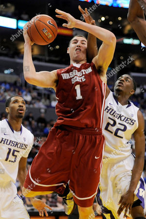 Klay Thompson, Scott Suggs, Justin Holiday Washington State's Klay Thompson, center, puts up a shot between Washington's Scott Suggs, left, and Justin Holiday during the first half of an NCAA college basketball game in the Pacific-10 tournament, in Los Angeles