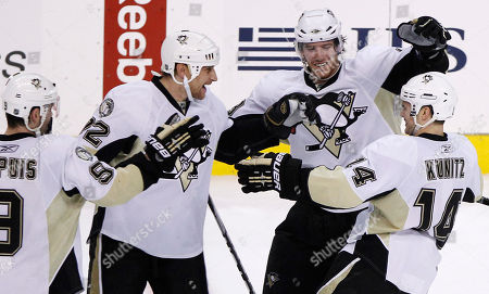 Chris Kunitz, Alexei Kovalev, James Neal, Pascal Dupuis Pittsburgh Penguins' Chris Kunitz, from right, celebrates with James Neal, Alexei Kovalev, of Russia, and Pascal Dupuis after Kunitz's goal during the shootout in an NHL hockey game against the Philadelphia Flyers, in Philadelphia. Pittsburgh won 2-1