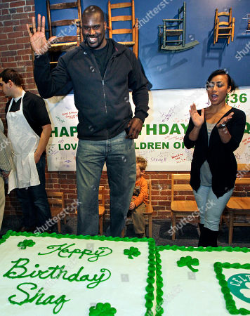 Shaquille O'Neal, Nikki Alexander Boston Celtics basketball star Shaquille O'Neal, left, waves as his girlfriend Nikki Alexander applauds during the Children's Museum to celebrate his 39th birthday, in Boston