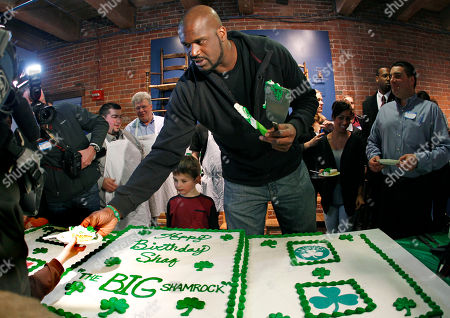 Shaquille O'Neal Boston Celtics basketball star Shaquille O'Neal hands out birthday cake at the Children's Museum to celebrate his 39th birthday, in Boston