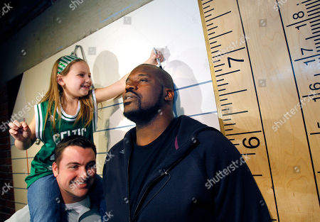 Shaquille O'Neal Boston Celtics basketball star Shaquille O'Neal, right, stands near an oversized ruler at the Children's Museum, in Boston, as Caroline Sprince, 8, of Lynnfield, Mass., measures his height. O'Neal was celebrating his 39th birthday