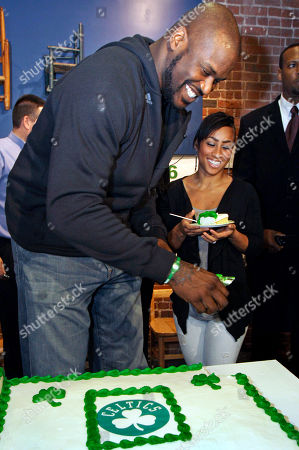 Shaquille O'Neal, Nikki Alexander Boston Celtics basketball star Shaquille O'Neal smiles as he shares birthday cake with his girlfriend Nikki Alexander, right, at the Children's Museum to celebrate his 39th birthday, in Boston