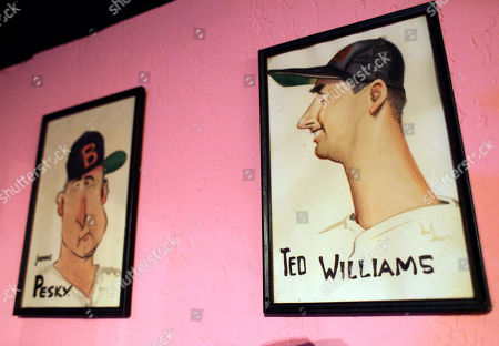 Caricatures of baseball greats Ted Williams, right, and Johnny Pesky, left, hang at the Pink Pony restaurant in Scottsdale, Ariz. It used to be the spring training hot spot. Then, it was gone. Back in the day, the Pink Pony attracted Dizzy Dean, Mickey Mantle, Billy Martin and Ted Williams. Now the Pink Pony is back and creating a Cactus League buzz _ and it's not so different under new management
