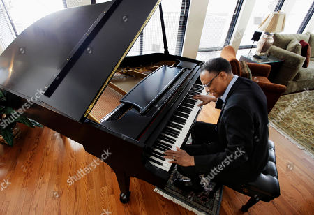 """Stock Image of Ramsey Lewis Jazz pianist and composer Ramsey Lewis plays the piano at his home in Chicago. His latest work is a tribute to Abraham Lincoln, """"Proclamation of Hope: A Symphonic Poem by Ramsey Lewis."""" It airs nationally on PBS stations starting Thursday"""