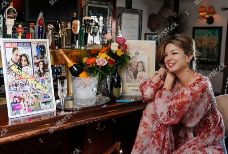 Stock Photo of Golriz Moeini This photo shows pub owner Golriz Moeini with decorations she plans to use for her royal wedding watch party at her White Harte Pub in Woodland Hills, Calif. It's two weeks until Americans set their alarm clocks for the wee hours of the morning to watch Prince William marry Kate Middleton, and already the royal fever is heating up across the Atlantic Ocean