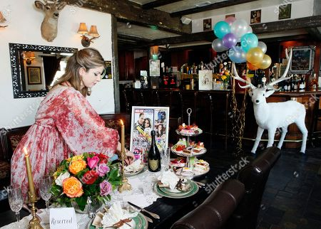 Stock Image of Golriz Moeini This photo shows pub owner Golriz Moeini as she decorates her White Harte Pub with items she plans to use for her royal wedding watch party at the pub in Woodland Hills, Calif. It's two weeks until Americans set their alarm clocks for the wee hours of the morning to watch Prince William marry Kate Middleton, and already the royal fever is heating up across the Atlantic Ocean