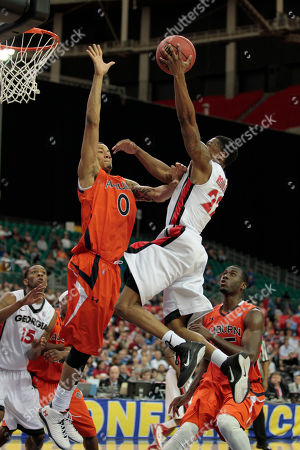 Georgia Bulldogs guard Gerald Robinson (22) goes to the hoop as Auburn Tigers guard Josh Langford (0) defends during the second half of an NCAA Southeastern Conference college basketball game in Atlanta