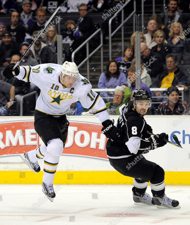 Stock Image of Brenden Morrow, Drew Doughty Dallas Stars left wing Brenden Morrow, left, jumps past Los Angeles Kings defenseman Drew Doughty as they go after the puck during the third period of an NHL hockey game, in Los Angeles. The Kings won 3-1