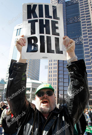 Stock Picture of David Shutt, 60, participates in a protest outside the Statehouse during the State of the State speech by Gov. John Kasich, in Columbus, Ohio. Shutt works in maintenance in Tiffin, Ohio