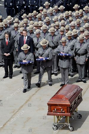 New York State Troopers attend the funeral of New York State Trooper Kevin Dobson at the Eastern Hills Wesleyan Church in Amherst, N.Y., . Dobson was was hit by a car and killed while writing a traffic ticket