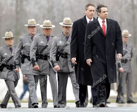 Andrew Cuomo, Robert Duffy New York Gov. Andrew Cuomo, front, and Lt. Gov. Robert Duffy, back, attend the funeral of New York State Trooper Kevin Dobson at the Eastern Hills Wesleyan Church in Amherst, N.Y., . Dobson was was hit by a car and killed while writing a traffic ticket