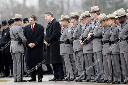 Andrew Cuomo, Robert Duffy New York Gov. Andrew Cuomo, center, and Lt. Gov. Robert Duffy right, greet a New York State Trooper, left, while attending the funeral of New York State Trooper Kevin Dobson at the Eastern Hills Wesleyan Church in Amherst, N.Y., . Dobson was was hit by a car and killed while writing a traffic ticket