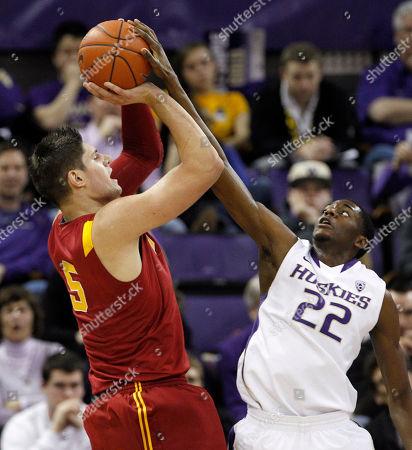 Nikola Vucevic, Justin Holiday Washington's Justin Holiday (22) blocks a shot by Southern California's Nikola Vucevic in the first half of an NCAA college basketball game, in Seattle
