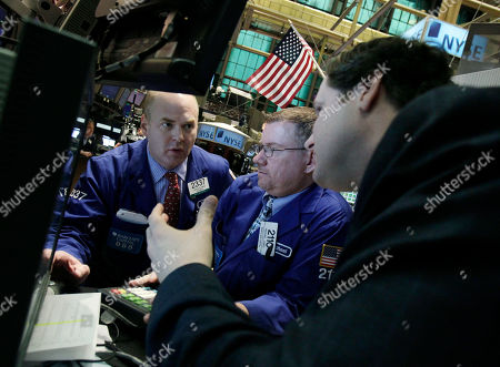 Evan Solomon, Michael Jones, Gregg Maloney Specialists Evan Solomon, left, Michael Jones, center, and Gregg Maloney confer at a post on the floor of the New York Stock Exchange