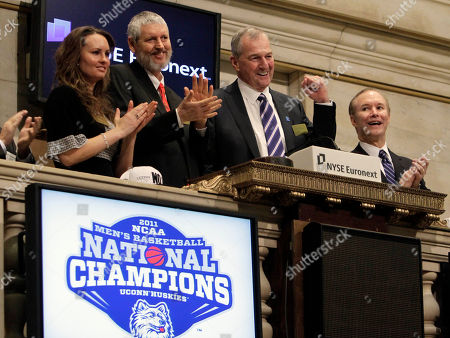 Stock Image of Jim Calhoun, Sara Howard, Richard Howard, Bob Kimble Jim Calhoun, third left, head coach of the University of Connecticut's men's basketball team, is joined by UConn alumni Sara and Richard Howard, left, and Bob Kimble, right, during opening bell ceremonies at the New York Stock Exchange