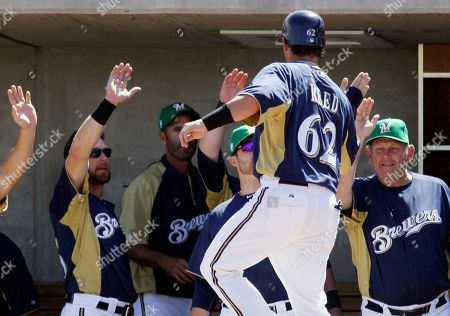 Jeremy Reed Milwaukee Brewers' Jeremy Reed (67) celebrates with teammates after scoring on a single hit by Edwin Maysonet during the first inning of a spring training baseball game against the Chicago White Sox, in Phoenix