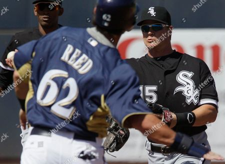 Gordon Beckham, Jeremy Reed Chicago White Sox second baseman Gordon Beckham, right, throws to first after forcing out Milwaukee Brewers' Jeremy Reed (62) during the fourth inning of a spring training baseball game, in Phoenix. The Brewers' Yuniesky Betancourt was out at first