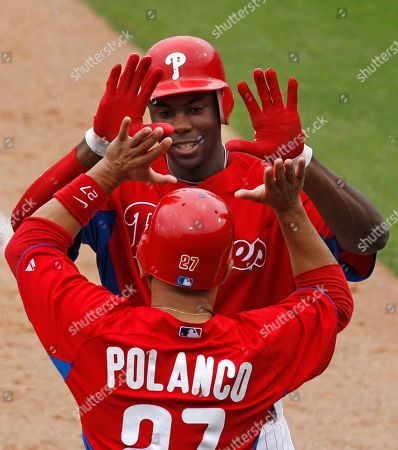 John Mayberry Jr., Placido Polanco Philadelphia Phillies John Mayberry Jr., top, celebrates his sixth-inning, two-run home run with Placido Polanco, below, who scored on the play, in the Phillies 7-0 shutout of the New York Yankees in their spring training baseball game at Brighthouse Field in Clearwater, Fla