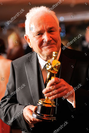 """David Seidler David Seidler holds his oscar for best original screen play for """"The King's Speech"""" at the Governors Ball following the 83rd Academy Awards, in the Hollywood section of Los Angeles"""